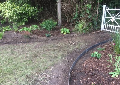 Steel edging around flowerbeds