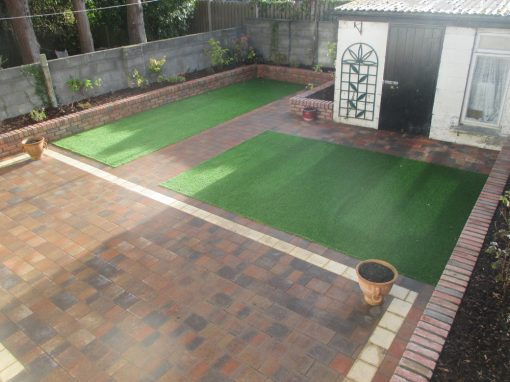 Shannon heather with gold border and raised walls with artificial grass.