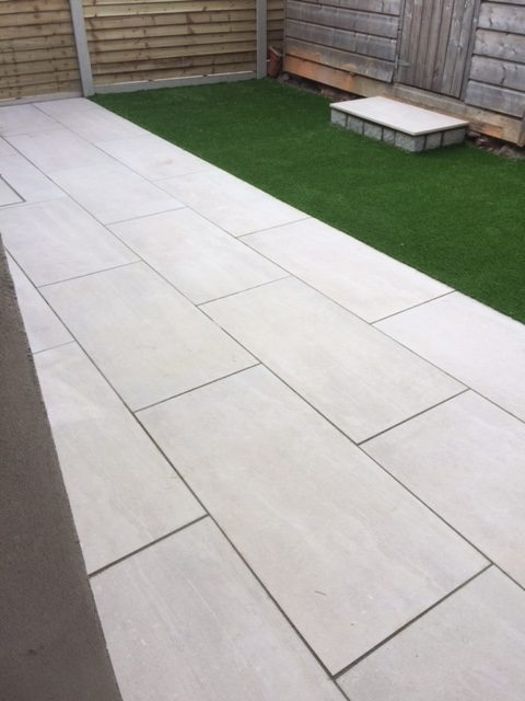 Porcelain slabs with Artificial Grass