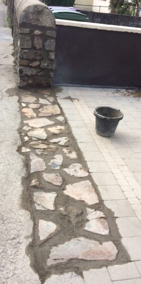 Removing stone wall.