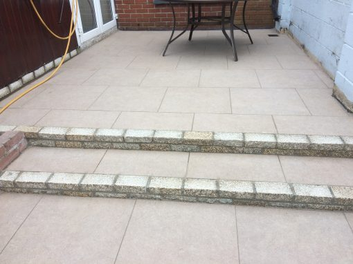 Porcelain paving with Portuguese granite steps.