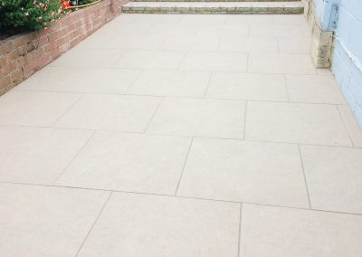 Porcelain patio with Portuguese granite steps